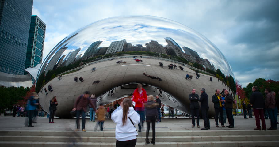 "Chicago, Illinois, USA - view of Cloud Gate ""the bean"" with pedestrians and reflections of skyline and people at Millennium Park with blue sky and few clouds - Timelapse without motion - October 2014"