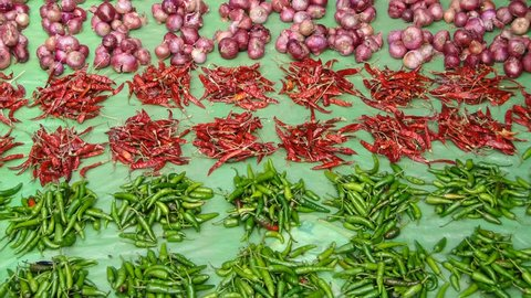 Piles of hot peppers and onions displayed at the  weekly market on Nov 12, 2009 in Ankadeli, Orissa in India
