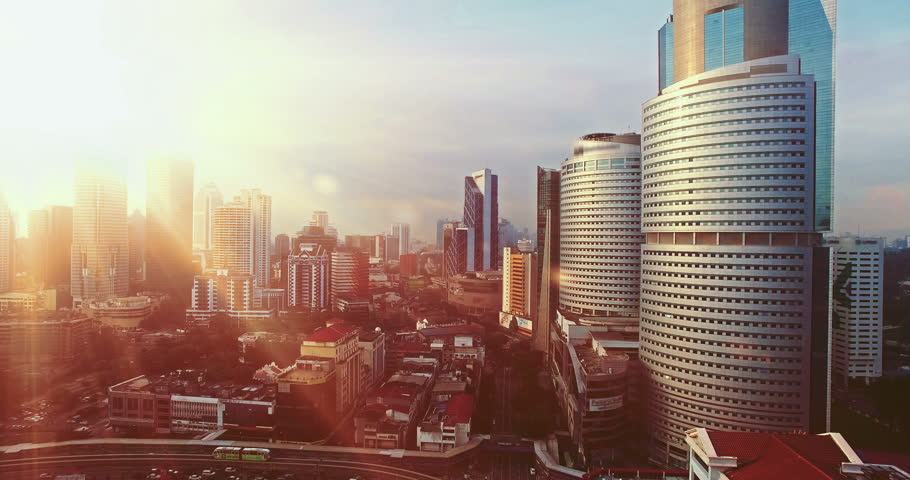 Cinematic style. Aerial view of Kuala Lumpur during sunrise with the sun in between of the Kuala Lumpur City Centre building