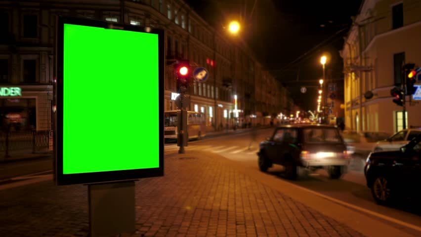 A Billboard with a Green Screen on a Busy Night Street.Time Lapse.   Shutterstock HD Video #17630920