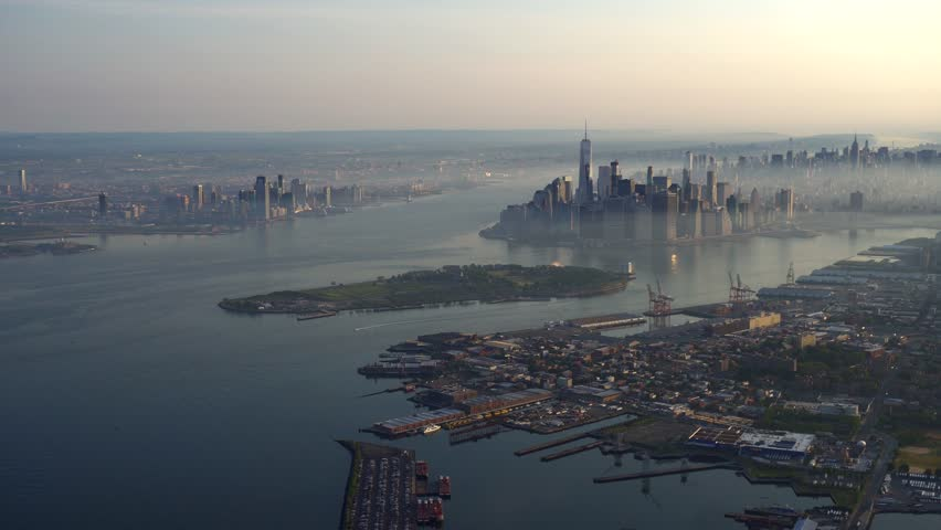 Manhattan Downtown and Brooklyn WIDE AERIAL neutral color. 4K 100 mps aerials of NYC. From dedicated aircraft, no plastic windows, gyro stabilized.