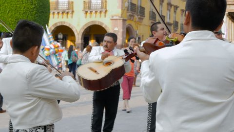 SAN MIGUEL DE ALLENDE, MEXCIO - CIRCA MAY 2016 - Mariachi band members perform for tourist with audio