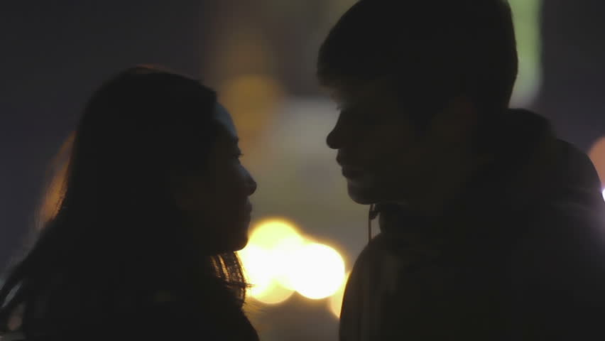 First timid kiss of teenage couple at romantic date, happy love story beginning