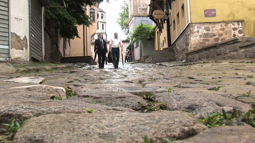 PLOVDIV, BULGARIA - CIRCA MAY 2007: People walk the cobblestone street circa May 2007 in downtown Plovdiv.