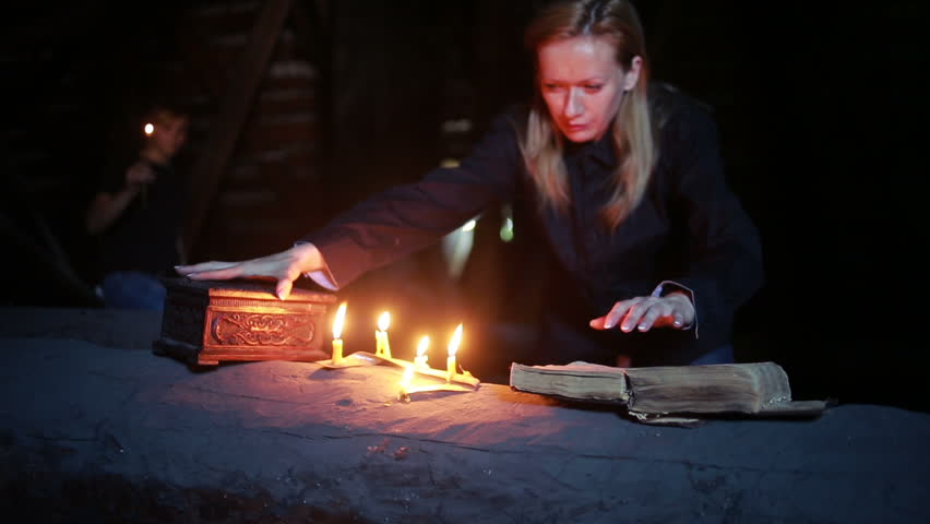 Witch holding the magic ritual. old book and candle. halloween | Shutterstock HD Video #17721169