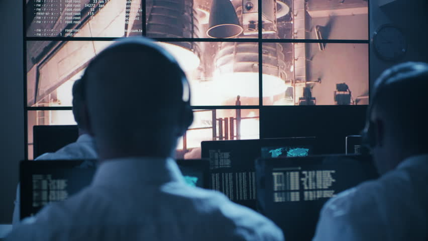 Group of People in Mission Control Center filled with Displays, Celebrating Successful Rocket Launch. Elements of this image furnished by NASA. Shot on RED Cinema Camera in 4K. | Shutterstock HD Video #17724679