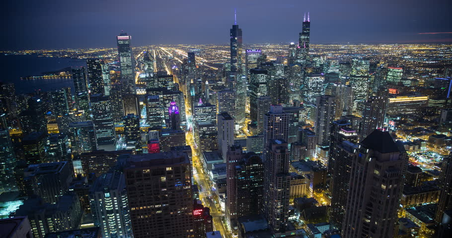 Chicago, Illinois, USA - view from the observatory of illuminated City facing south at night - Timelapse with zoom in