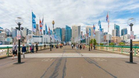 Sydney, Australia - June 26, 2016: 4k hyperlapse video of walking along the Pyrmont Bridge in Darling Harbour of Sydney