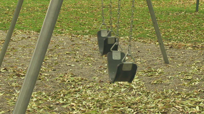 Empty swing seats at a playground | Shutterstock HD Video #1773914