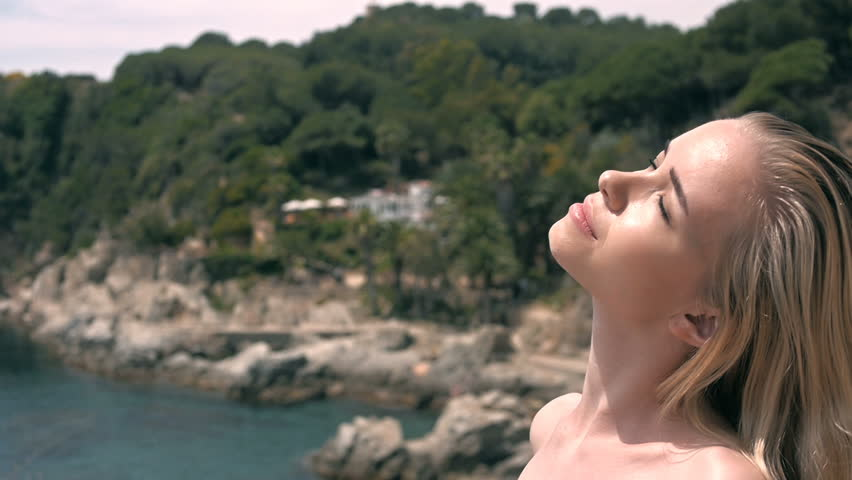 portrait of fashion blonde model posing on the beach #17785789