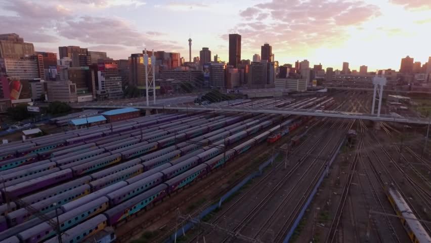 Low Level Aerial shot over of Nelson Mandela Bridge at sunrise in Johannesburg