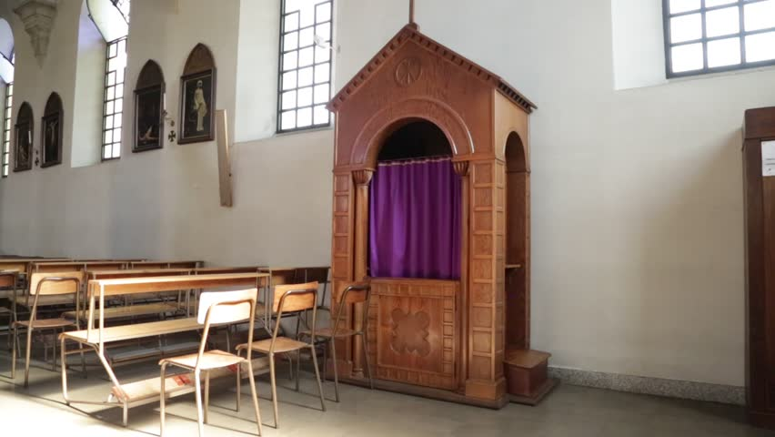 MILAN,ITALY-CIRCA JUNE 2016- inside the old church and confession box