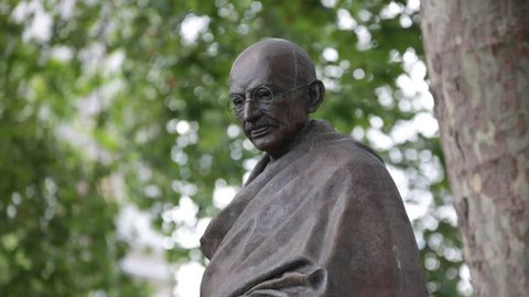 Statue of Mahatma Gandhi on Parliament square, London Mid Shot