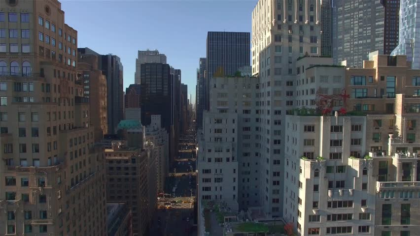 NEW YORK - SEPTEMBER 21: Aerial real time shot, camera is flying along West 95th Street filming building and 7th Avenue on September 21 in New York. Essex House.