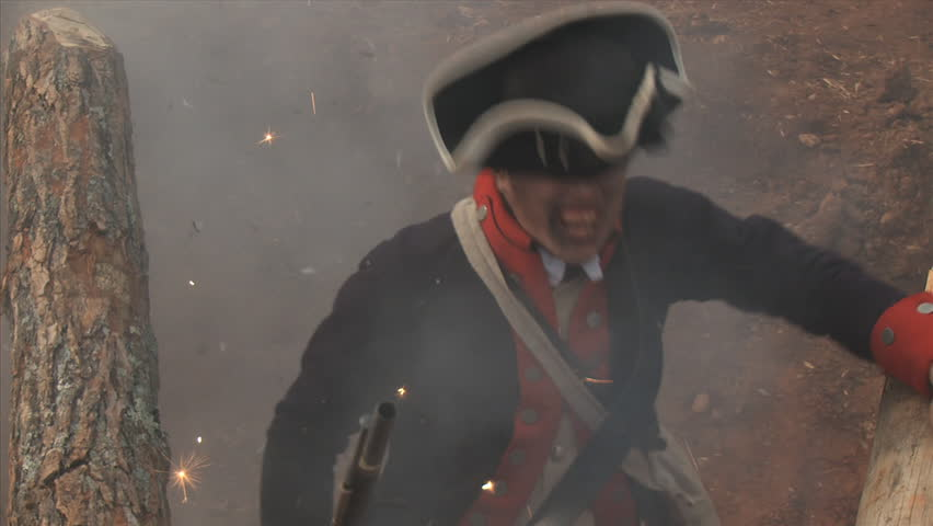 VIRGINIA - OCTOBER 2014 - Reenactment, large-scale, epic American Revolutionary War anniversary recreation -- in the middle of battle.  Cannons, Cavalry - Continental Soldier muskets fight the British