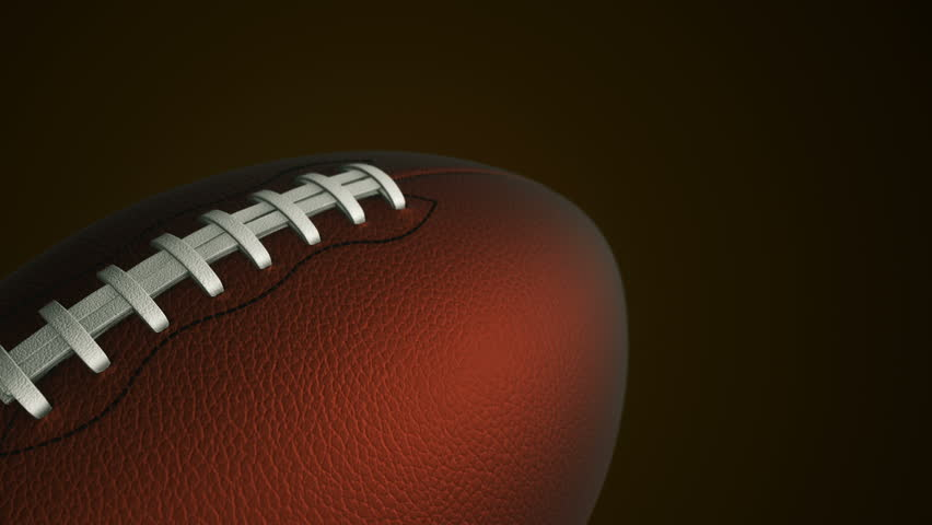 Animation of slow rotation ball for american football. View of close-up with realistic texture and light. Animation of seamless loop. | Shutterstock HD Video #17885599