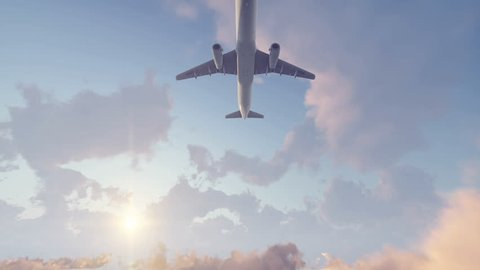 Passenger airplane flying overhead high in the sky above cumulus clouds at sunset. Realistic 3D animation rendered in 4K, ultra high definition.