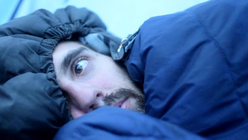 Man snuggled into his sleeping bag