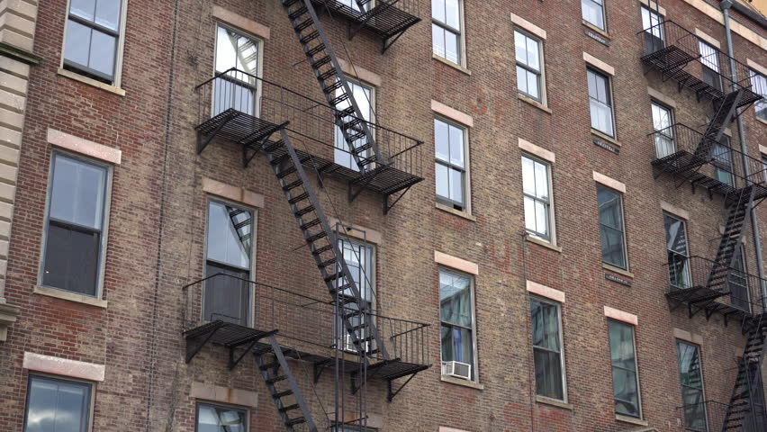 Brick Apartment Building Window exterior establishing shot of a new york style apartment building