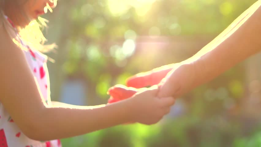 Grandma and child hands. Granny's Old hands playing with Child together. Happiness. Hands of baby and grandma close up in sun light. Slow motion 240 fps. Full HD 1080p