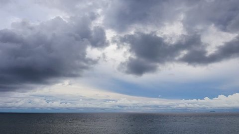 A high shot from Siquijor Island shores, showing the ocean view under an overcast sky. Apo Island can be seen in the distance.  Presented in real time and originally shot in 4K (Ultra HD) resolution.