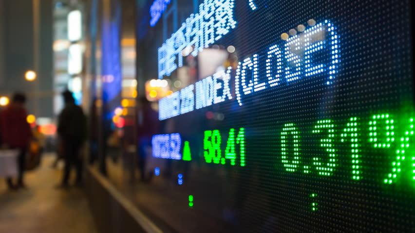 CU FOCUS ON FOREGROUND Trading Board With Street Reflections / Hong Kong, China(Hong Kong, China - November, 2015) | Shutterstock HD Video #18003079