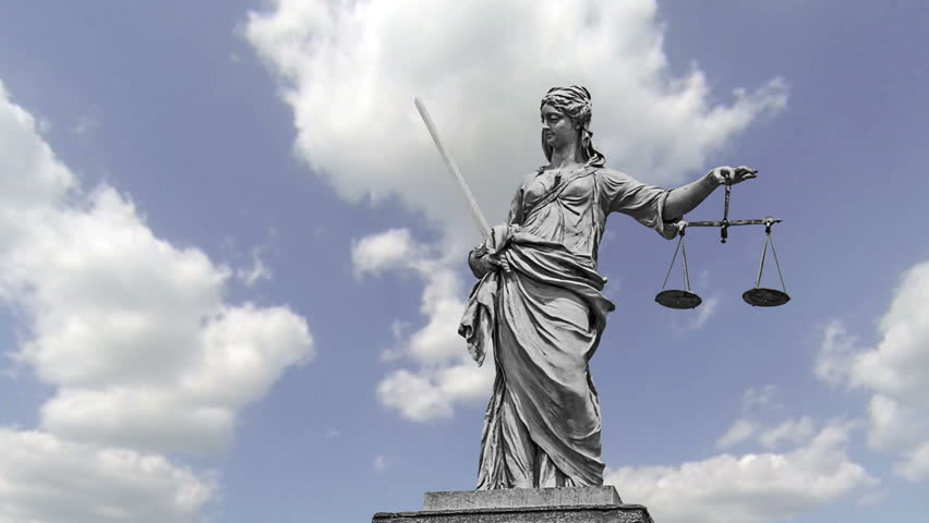 Statue of Lady Justice in front of moving clouds | Shutterstock HD Video #18037249