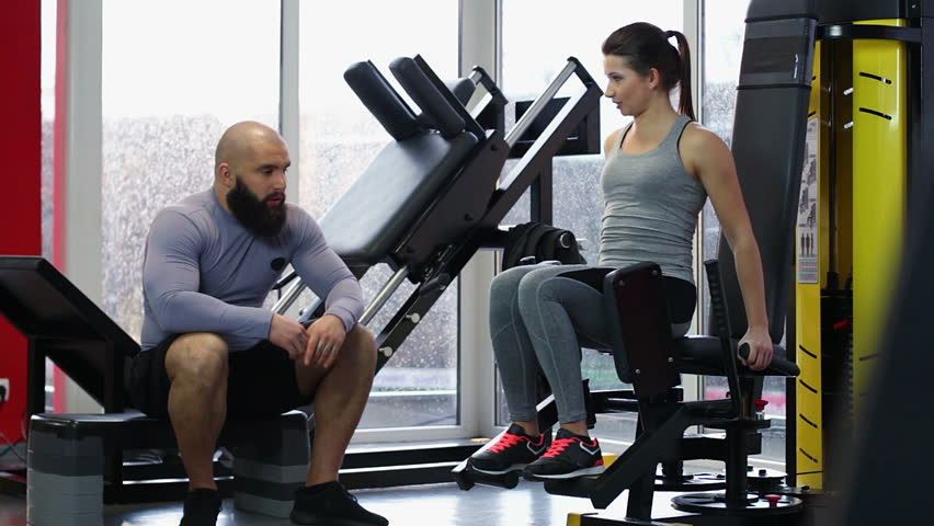 Personal Trainer Consulting Female Gym Visitor During Workout Active Lifestyle Hd Stock Clip