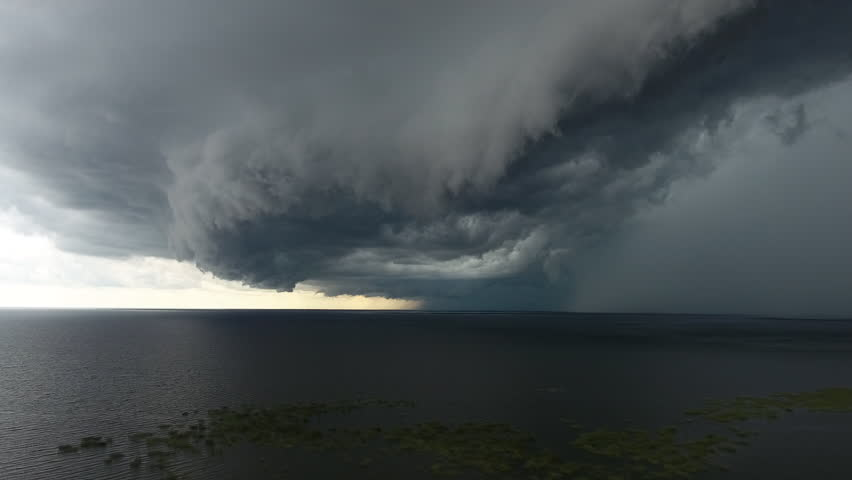Aerial severe thunderstorm with large shelf cloud and rain core over Lake Okeechobee and Florida Everglades. Descending moving shot. | Shutterstock HD Video #18111103