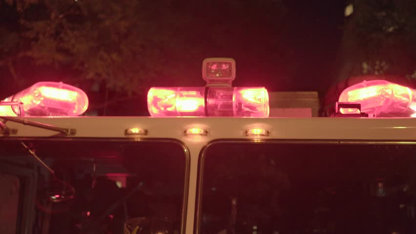 Fire department trucks with flashing siren lights standing in the city streets at night. rescue emergency scenery background | Shutterstock HD Video #18131839