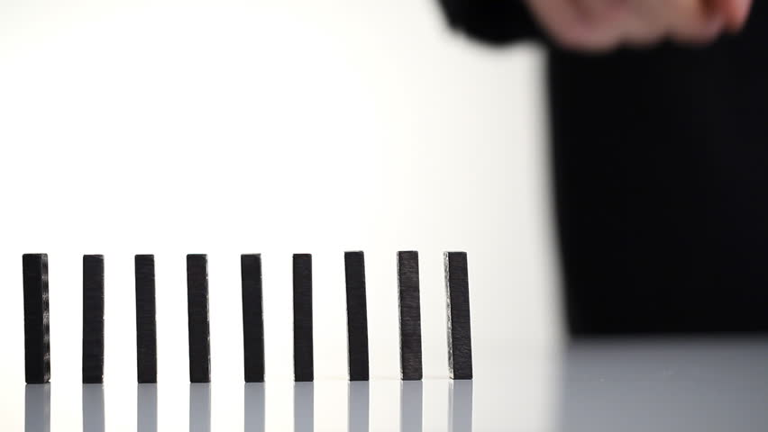 Hand starting a row of dominoes; entrepreneur or start-up concept | Shutterstock HD Video #1815626