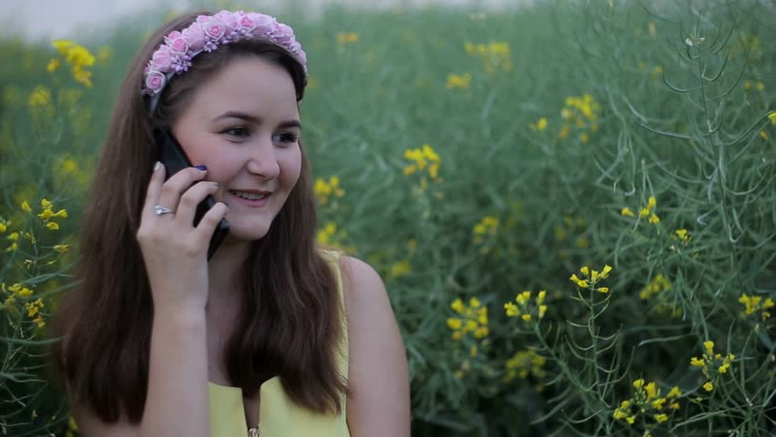 Young woman talking on mobile phone, girl on a field with a smartphone,gerl laughs,phoning | Shutterstock HD Video #18156829