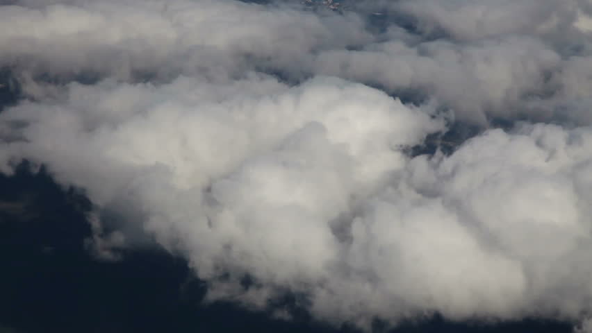 Timelapse flying (3X speed) above lots of clouds and land, airplane shot #1820789
