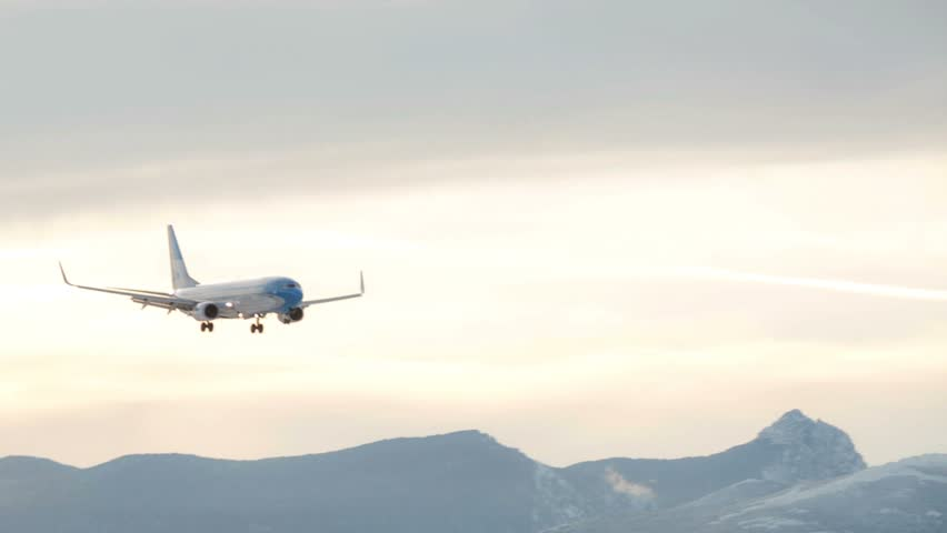 BARILOCHE, ARGENTINA - JULY 27, 2016: Aerolineas Argentinas plane landing at Bariloche international airport. Patagonia, Argentina