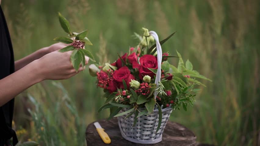 Creation of a flower arrangement of roses. | Shutterstock HD Video #18239770