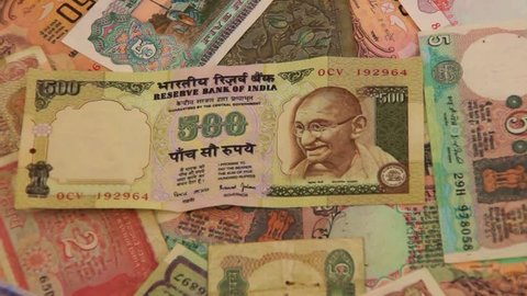 SEATTLE - JUL 1, 2016 - Portrait of Gandhi on Indian rupee currency notes,  rotating