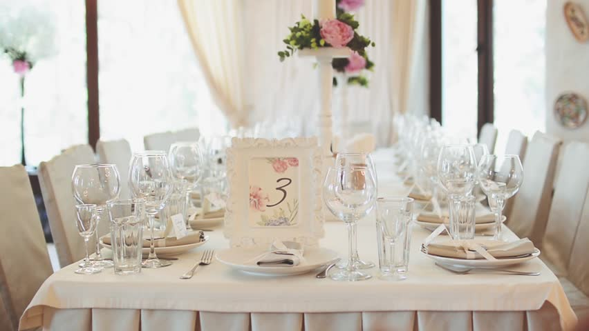 Wonderful Table Decorated For The Wedding Party, On The Table Is A Frame With Flowers  And