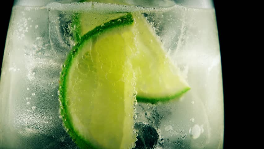 Refreshing summer cocktail with lime and tonic