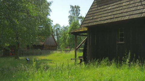 Gloomy Wooden Building in a Wooded Area. Broken Water Mill. Fragments of Ancient Buildings in the Park Polish Architecture