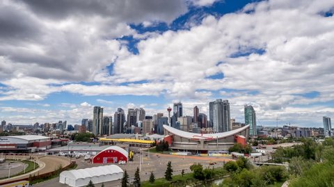 CALGARY, CANADA - JULY 23: Time-lapse of the Calgary skyline on July 23, 2014 in Calgary, Alberta. This vantage point is from Scotsman's Hill above the stampede grounds.