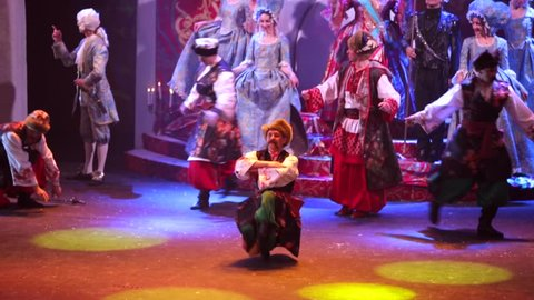 "MOSCOW, RUSSIA - JANUARY 20, 2016: First Russian folk-musical ""the Night before Christmas"" prepared by theatre of the Russian song. Dancing Cossacks in great national ukrainian costumes"