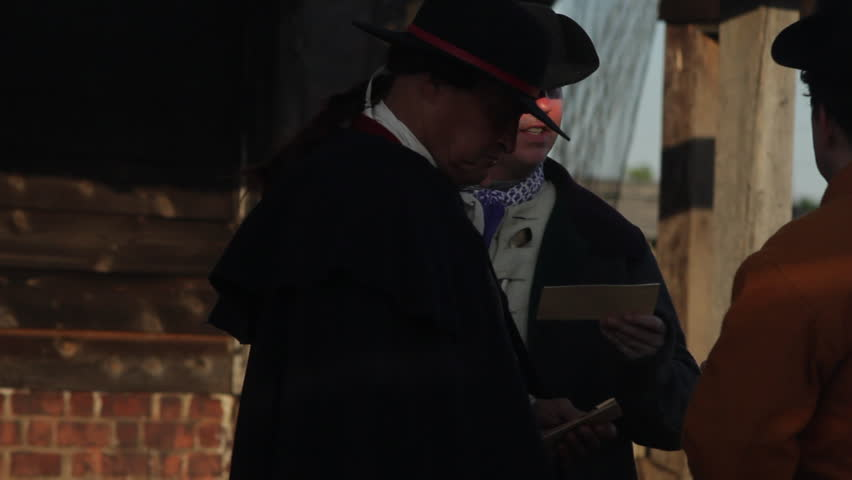 BOSTON - APRIL 1775 -- Reenactor, Re-enactment of Colonial American spy, Sons of Liberty. Taverns, men reading newspapers and conducting business before and during American Revolution. Commerce. Bar