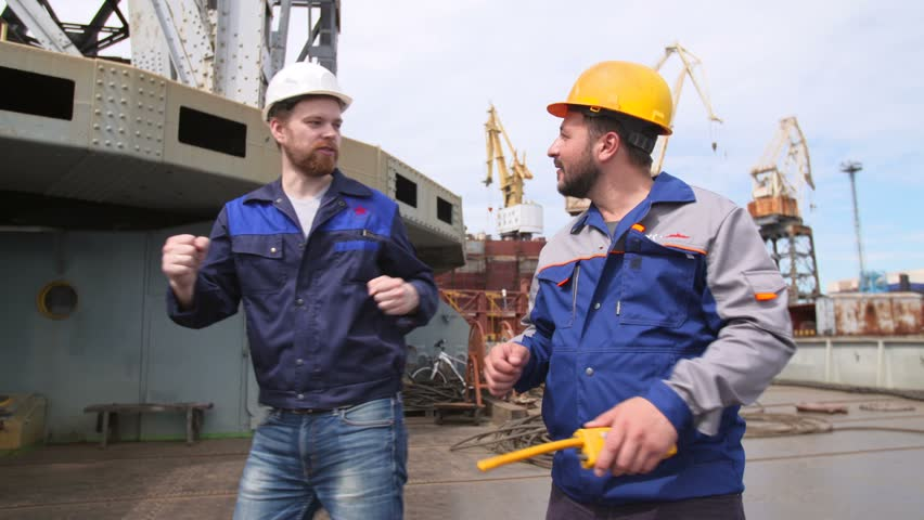 Funny dancing Dock worker and engineer in Shipping cargo port