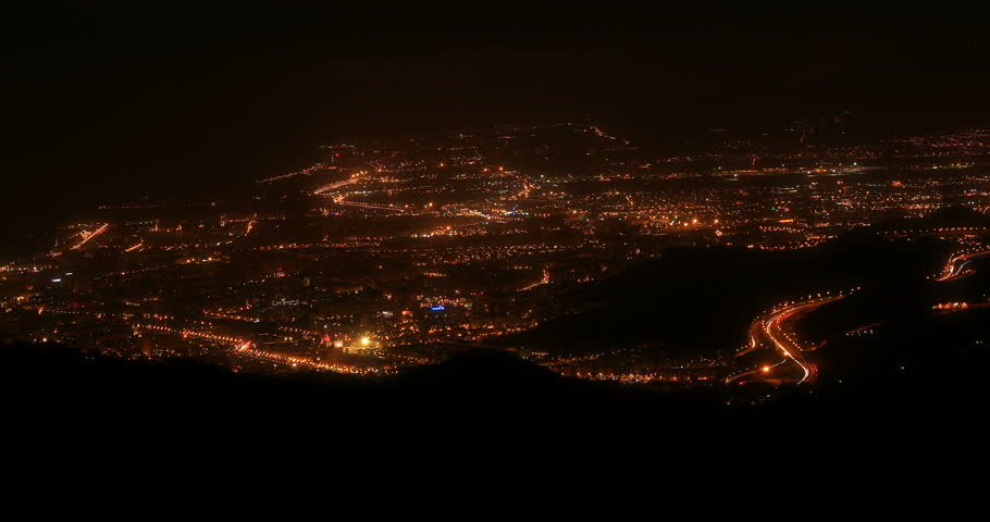 Timelapse pan looking over the city of Malaga Spain at night