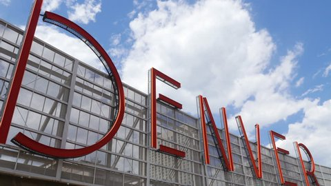 Denver, CO - July 16, 2016: A large Denver sign on the top of the Denver Pavilions shopping center in downtown Denver on a sunny summer day. Denver enjoys a beautiful climate with plentiful sunshine.