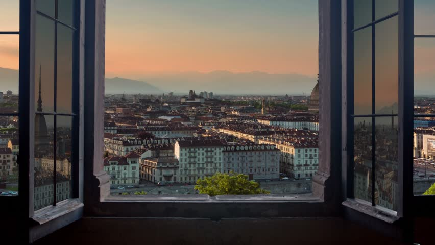 Turin skyline time lapse from day to night seen from a window | Shutterstock HD Video #18401539