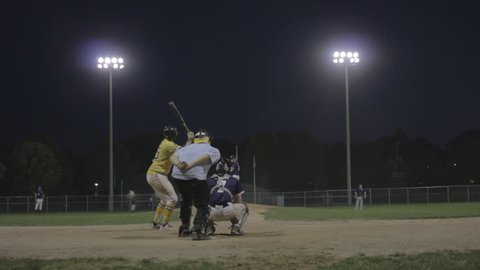 Baseball home run from behind home plate, night