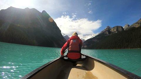 Female Kayaking on Lake Louise in the Canadian Rockies