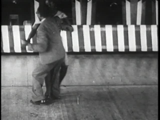 African American couple swing dancing, 1930s