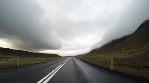 Driving pov stormy clouds misty mountain canyon peaks Iceland 4k